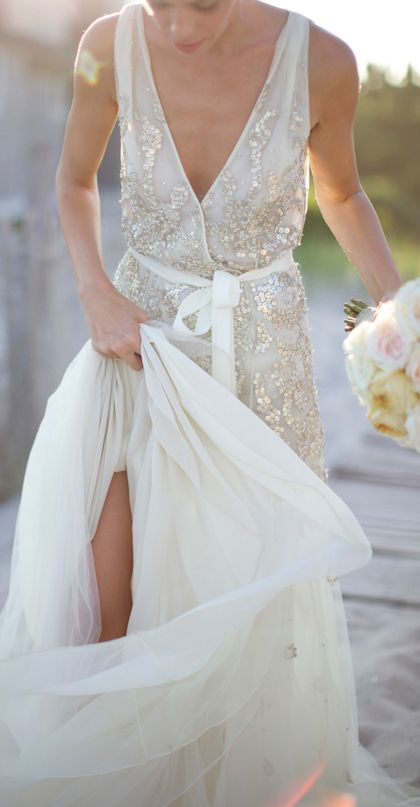 a wide strap wedding dress with a deep V cut, a sash and silver sequin detailing for a beach bride