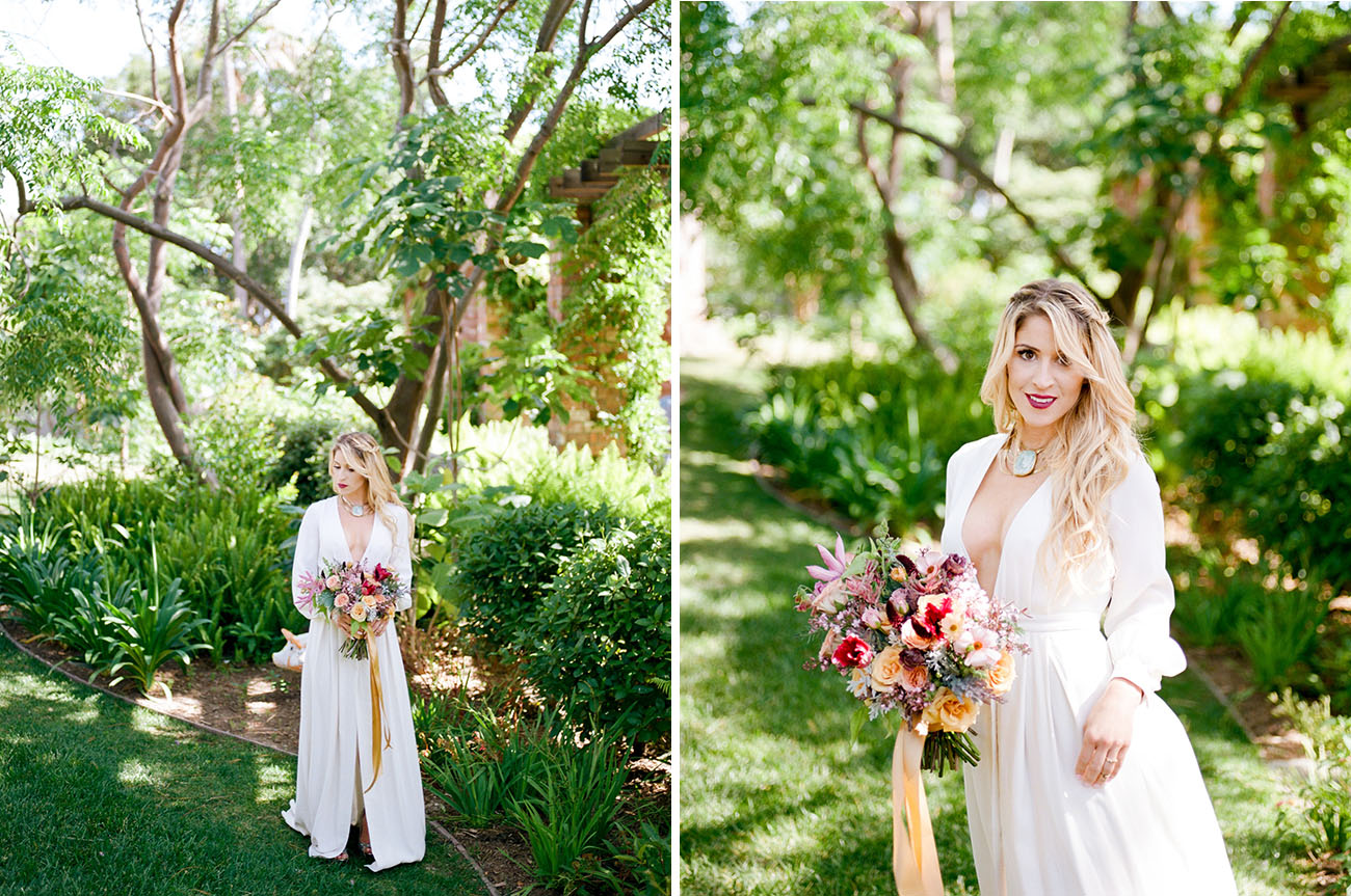 The bride was wearing a creamy wedding dress with a plunging neckline and long sleeves and a slit