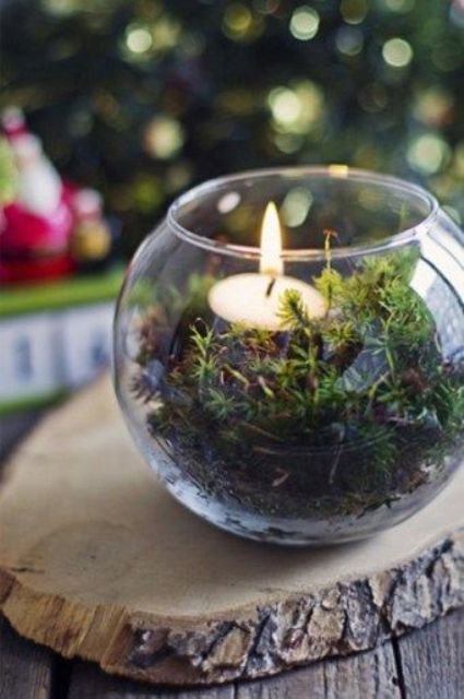 a glass bowl with moss and a tealight is a simple and cheap idea for a woodland wedding