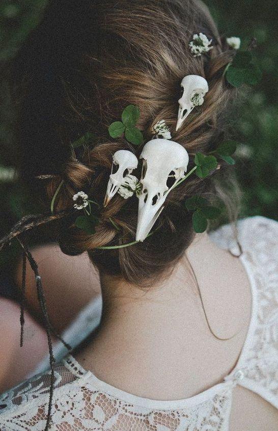 a wedding updo with shamrocks, skulls and twigs for a woodland wedding