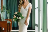03 a white sequin V cut wedding dress with short sleeves and a small train is a chic and timeless idea