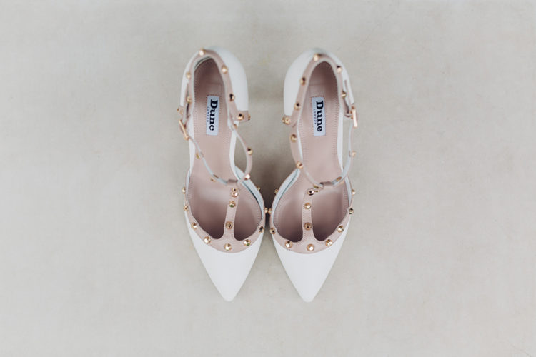 Creamy and brown bridal shoes with ankle straps and metallic detailing