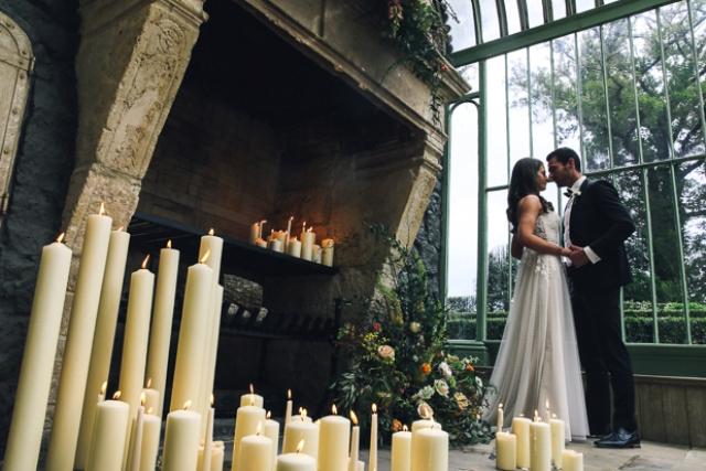 Lots of tall candles and beautiful florals are a stunning idea for a summer or spring ceremony