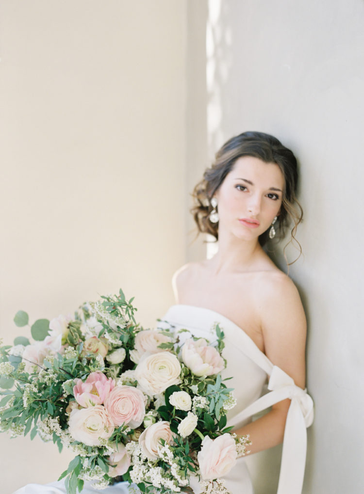 The bridal bouquet featured greenery, blush and white blooms