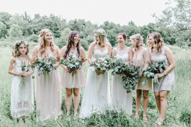 The bridesmaids in neutral mismatching dresses