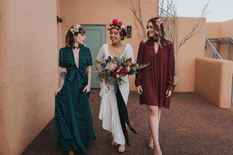 The bridesmaids were wearing a teal polka dot plunging neckline dress and a short burgundy one with long sleeves