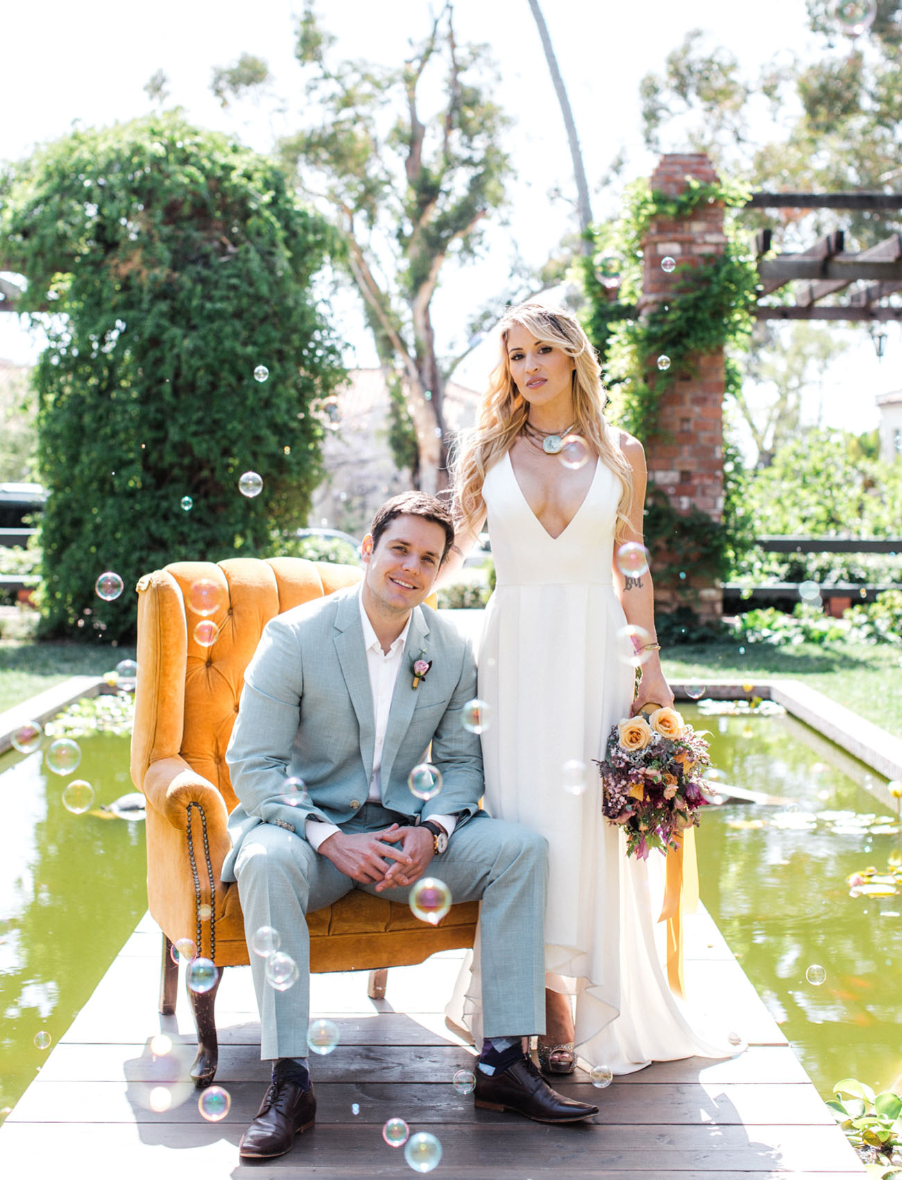 The second wedding dress was high low, with a plunging neckline and wide straps, the groom was wearing a light grey suit