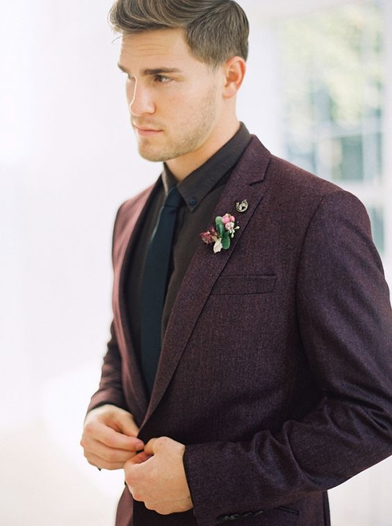 a dark purple two piece wedding suit, a brown shirt and a black tie