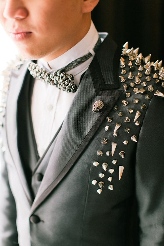 a rhinestone skull boutonniere and a skull bow tie for a rock groom look