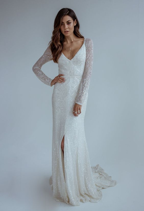 A White Sequin Long Sleeve Wedding Dress With Deep V Cut And Front