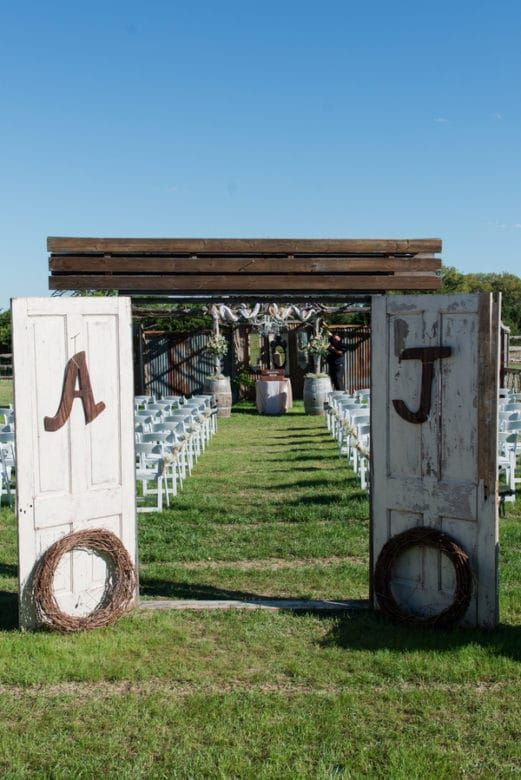 Picture Of Rustic Wedding Ceremony Space With Wooden Arches And Signs Vintage Doors