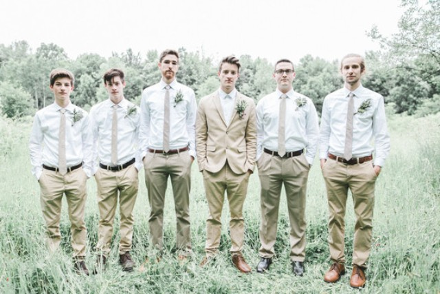 The groom in a beige suit and brown shoes, groomsmen dressed in the same colors