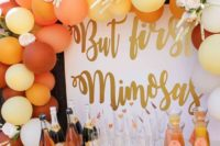 05 a mimosa bar decorated with colorful balloons and blooms