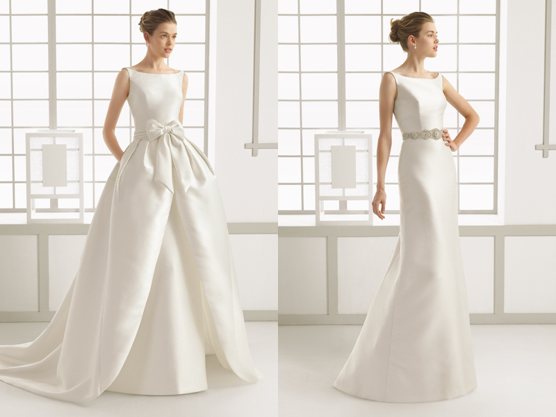 a modern plain wedding dress with a bateau neckline and a full overskirt of the same fabric