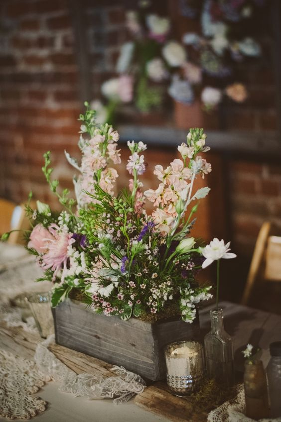 a reclaimed wooden box with moss and wildflowers for a relaxed summer wedding