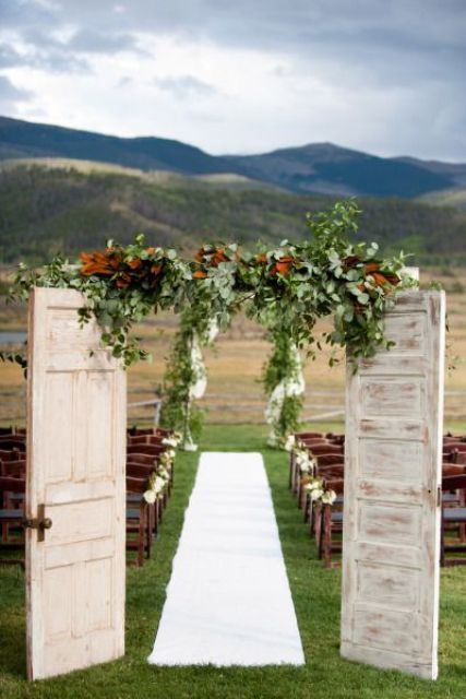 use rustic doors, leaves and greenery for the welcome doors and there can be nothing better than a naturally beautiful backdrop