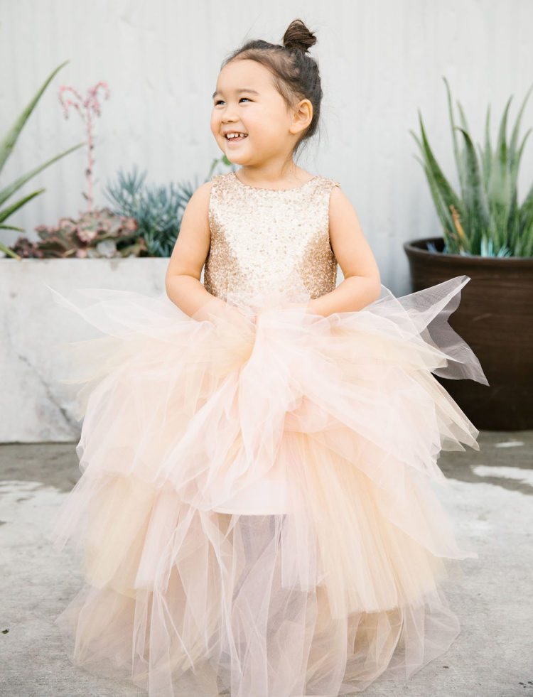 The flower girl in sequins and tulle by Miss Tashina looked heavenly