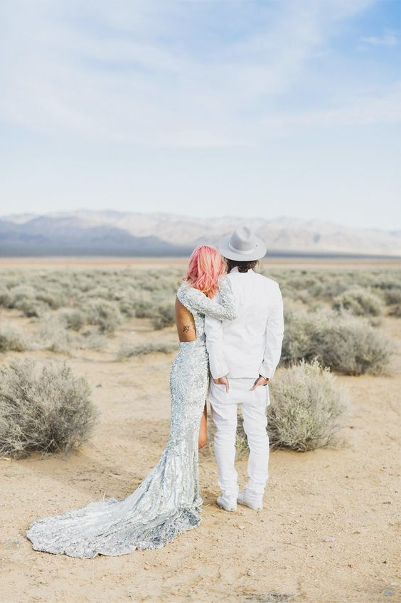 a backless long sleeve silver sequin mermaid wedding dress with a train for a different bridal look