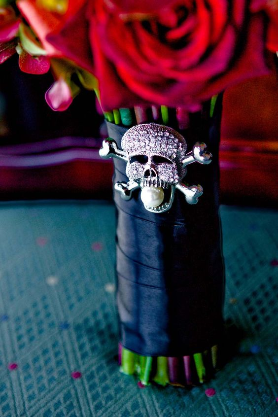 a black ribbon bouquet wrap with a rhinestone skull pin with a large pearl