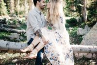 06 a boho couple with a bride-to-be in a floral dress, leather sandals and a tattooed groom in jeans