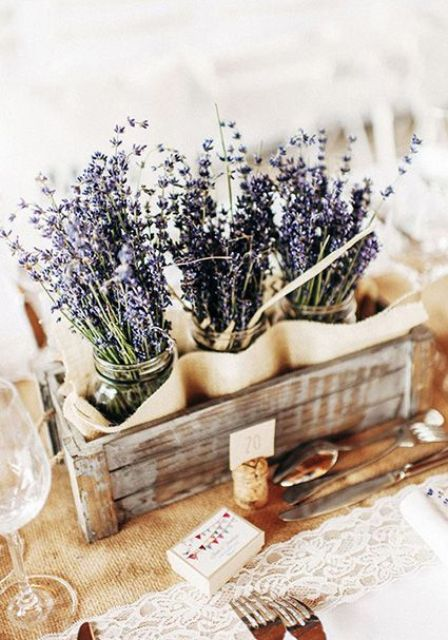 a shabby wooden box with lavender in jars is a gorgeous idea for Provence
