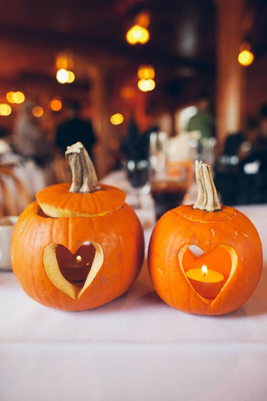real pumpkins with carved hearts and turned into wedding candle lanterns