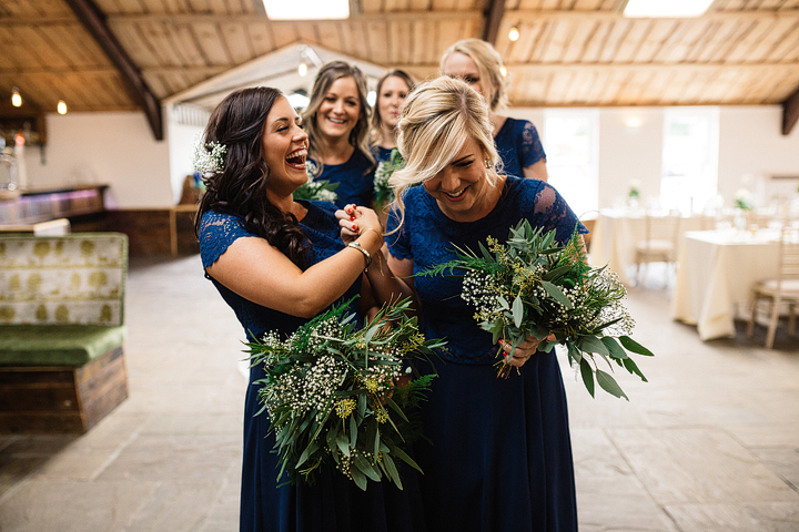 The bridesmaids were wearing navy knee dresses with lace bodices