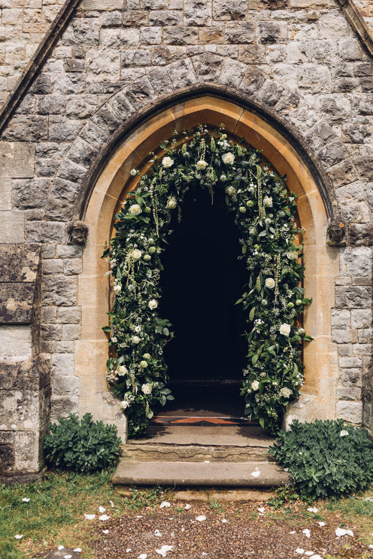 The ceremony took place in a church, which was decorated with lush greenery and flowers