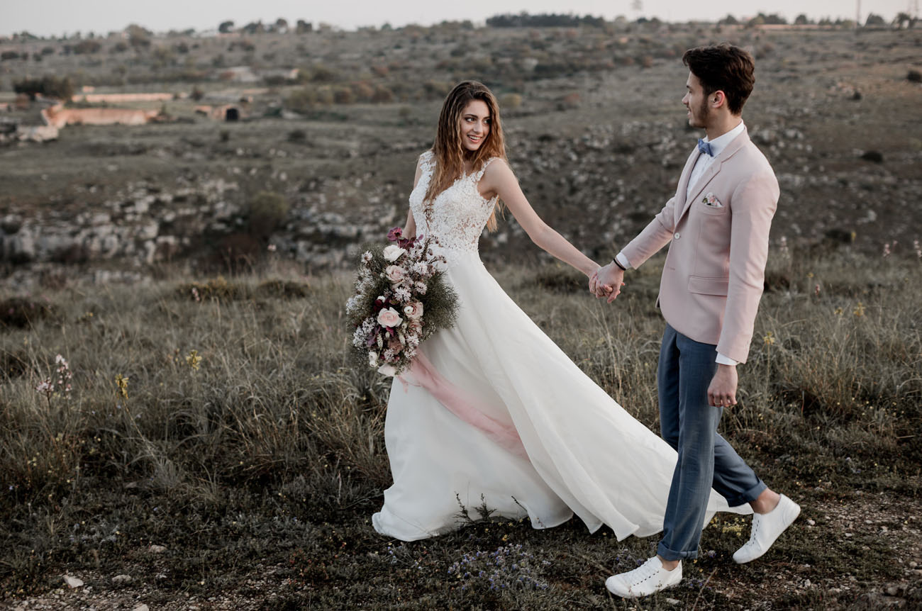 The groom was dressed very dashing, with a pink jacket and white sneakers