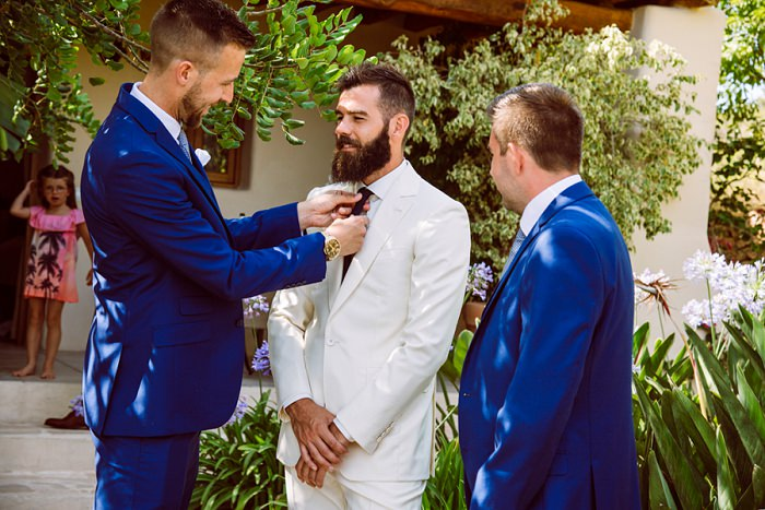 The groomsmen were wearing bold blue suits and blue ties