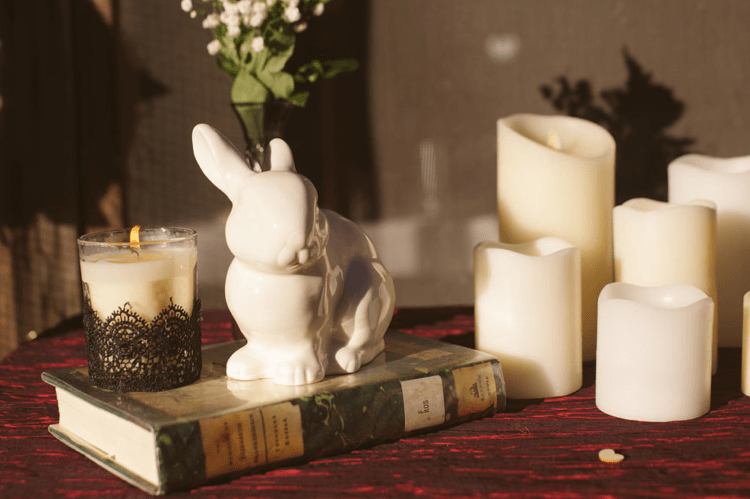 The tablescapes were decorated in grey and red, with lots of candles and toy bunnies as the couple's pet is a bunny