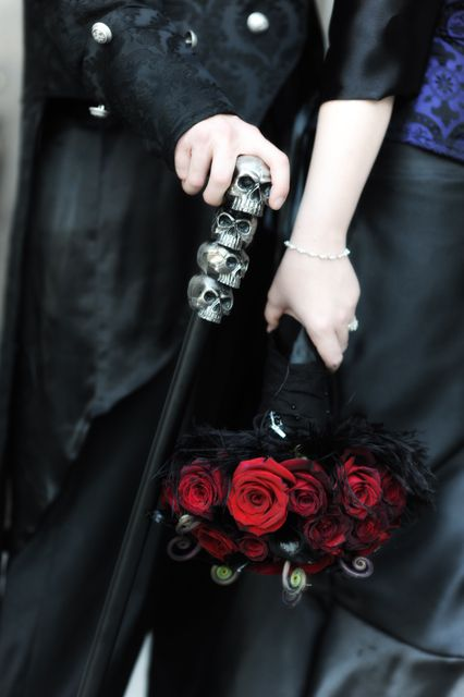 a cane with skulls on top for a Halloween or just moody groom look