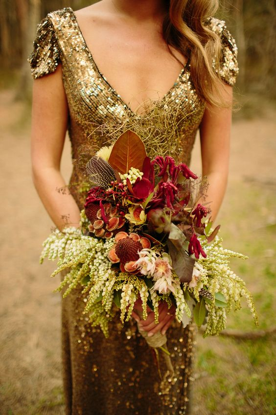 a deep V cut gold sequin wedding dress with cap sleeves for a glam fall bride