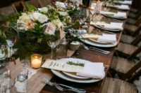 07 a rustic table setting with a burlap and lace table runner, evergreens and blooms, candles