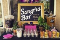 07 a sangria bar in black, pink and purple with a bead garland and a tassel one