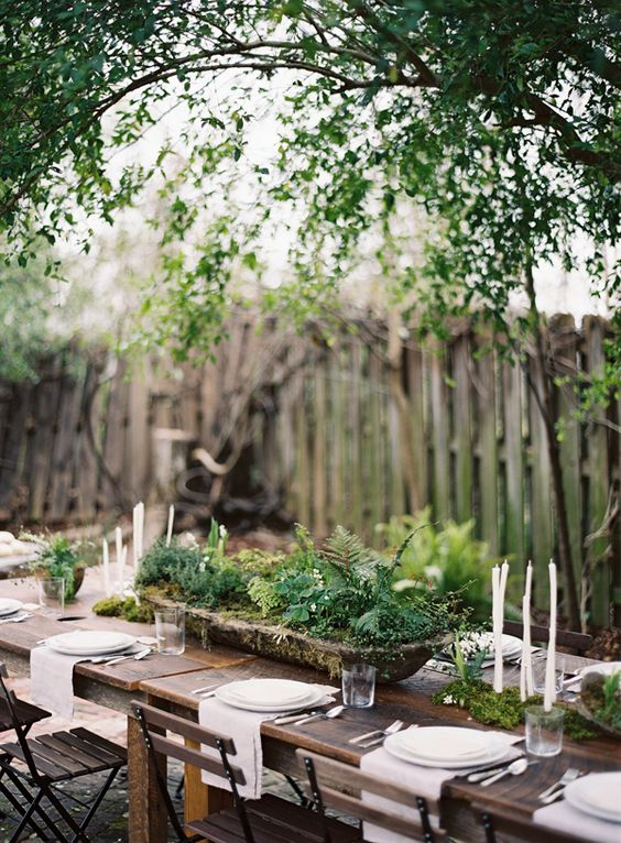 an antique wooden bowl with greenery for a relaxed woodland-inspired wedding