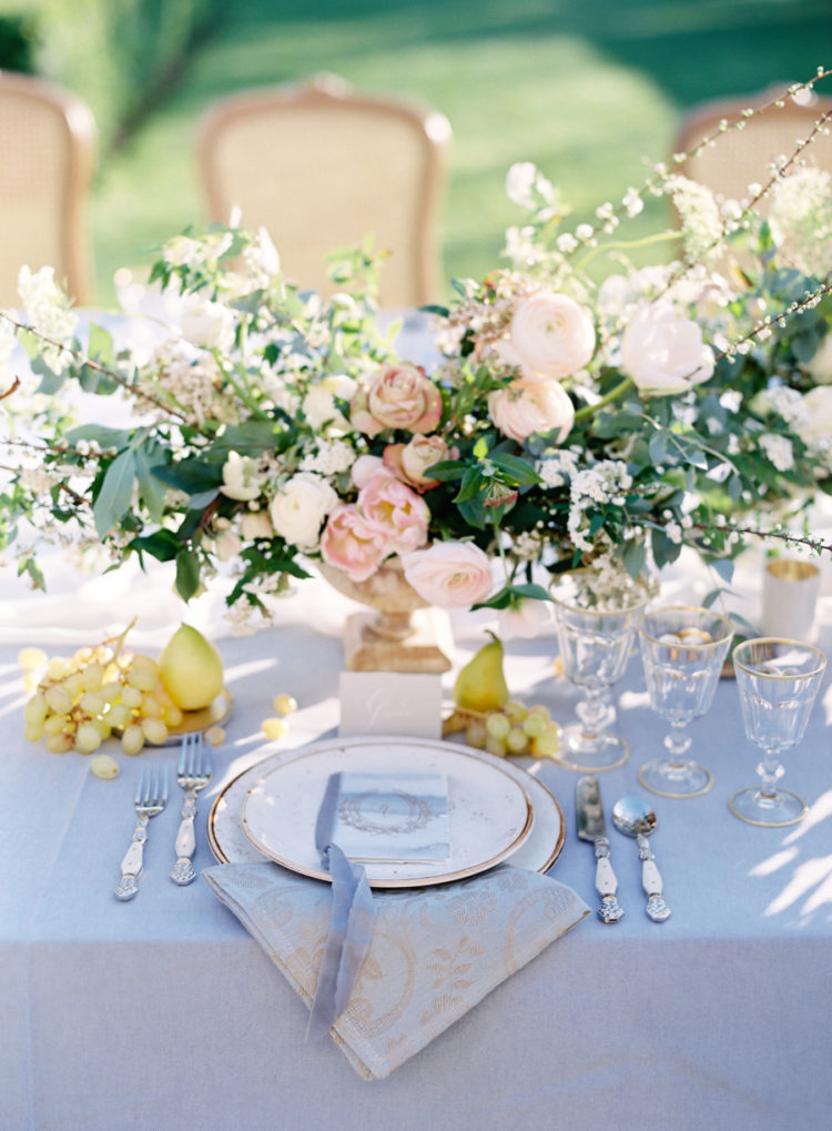 The wedding tablescape was done in pastels with sunny yellow touches and gold-rimmed items