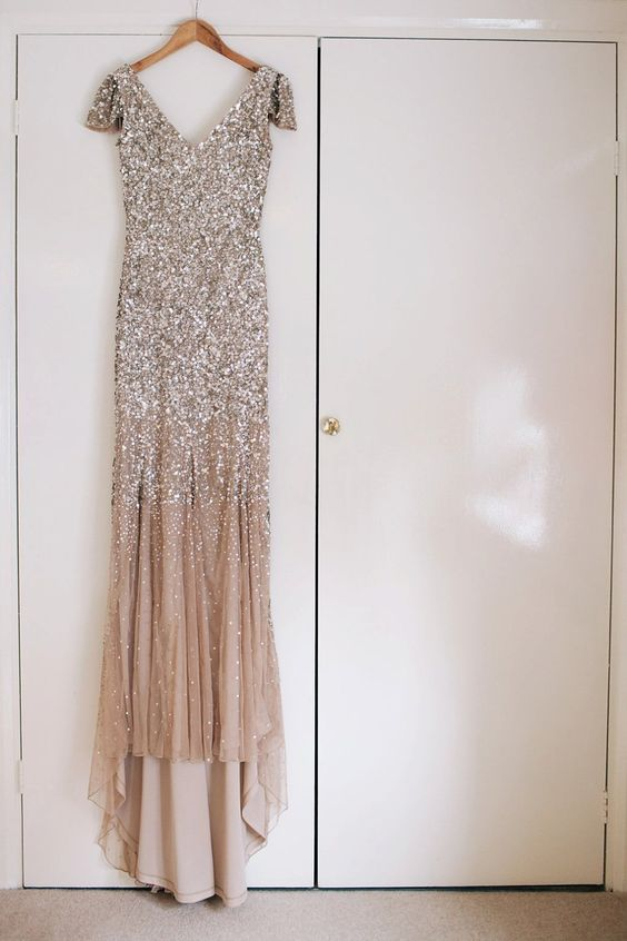 a nude wedding dress with a silver sequin bodice, cap sleeves and a train will be amazing for any glam bride