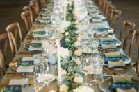 08 a tablescape with a lush greenery and peachy bloom runner, candles and copper flatware