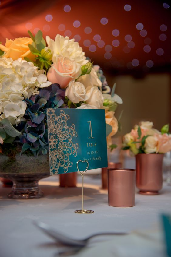 a teal and copepr wedidng table number, copper candle holders