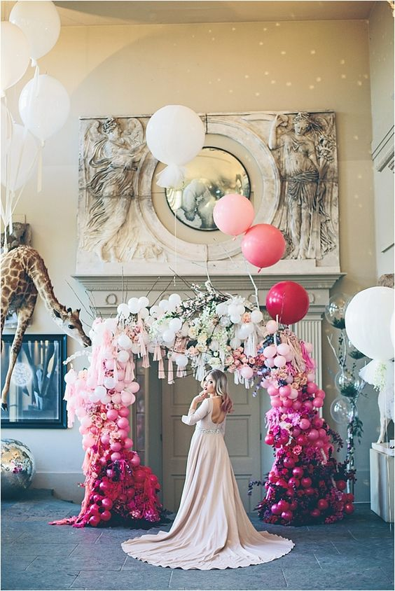 an ombre balloon, bloom and tassel wedding arch