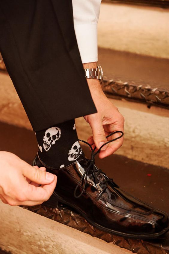 skull socks for a chic Halloween groom's look