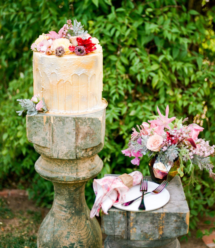 The wedding cake was a buttermilk-colored with a drip and fresh blooms on top
