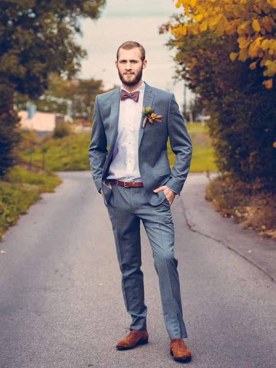 a grey two piece wedding suit with a plum bow tie and copper accessories