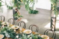 09 a lush greenery and white bloom table runner, no tablecloth, gold flatware and succulents
