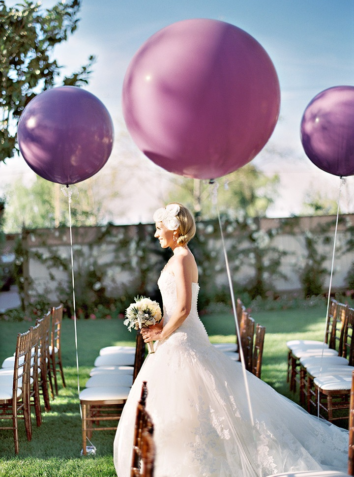 balloon wedding aisle decor - rock colorful balloons that match your color scheme