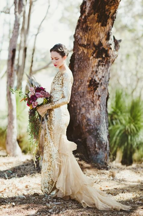 a sparkling gold sequin long sleeve dress with a fabric tail for a unique look