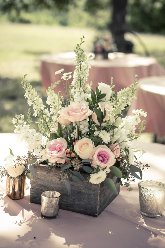 a wood box with pink roses and some wildflowers for a relaxed spring or summer wedding
