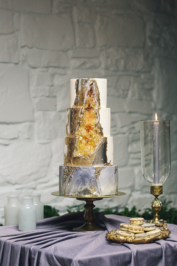 A super trendy wedding cake showing off three trends - metallic decor, geodes and marble in one