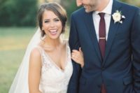11 a navy two piece wedding suit with a white shirt and a plum tie
